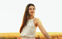 Sensual attractive young woman enjoy beauty of sunset Royalty Free Stock Image