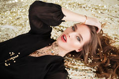 Sensual attractive young woman with sequins on her face Royalty Free Stock Photos