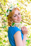 Sensual beautiful blond girl in a flowers Stock Images