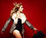 Sensual beautiful blonde woman posing in black lingerie. Royalty Free Stock Image
