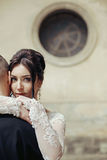 Sensual beautiful, brunette bride hugging groom face closeup, wi Stock Photography