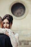 Sensual beautiful, brunette bride hugging groom face closeup, wi Stock Photography