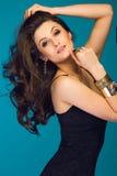 Sensual beautiful brunette woman on blue background Stock Image