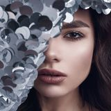 Sensual beautiful brunette woman in a shiny fashion dress of sequins Stock Image