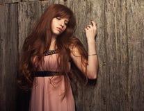 Sensual beautiful redheaded girl. Beautiful sensual redheaded girl in a pink dress and long hair Royalty Free Stock Photo