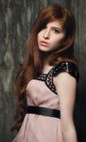 Sensual beautiful redheaded girl. Portrait of beautiful sensual red-haired girl on wooden background Stock Photos