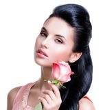 Sensual beautiful woman with pink rose. Stock Photography