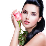 Sensual beautiful woman with pink rose. Royalty Free Stock Image
