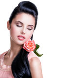 Sensual beautiful woman with pink rose. Stock Photo