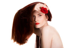 Sensual beautiful woman with red rose. Portrait of sensual beautiful woman with red rose on white background Stock Images