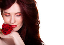 Sensual beautiful woman with red rose. Portrait of sensual beautiful woman with red rose on white background Royalty Free Stock Photography
