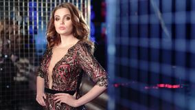 Sensual beautiful young woman wearing vintage luxury dress and glamour make-up on disco background stock video