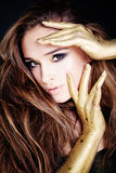 Sensual Beauty. Beautiful Model with Golden Makeup. Sensual Beauty. Beautiful Model with Golden Make-up royalty free stock image