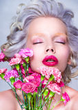 Sensual Beauty portrait of blonde pretty woman with flowers. Skin care and hair care Stock Photo
