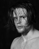 Sensual black and white portrait of a young man Royalty Free Stock Photo