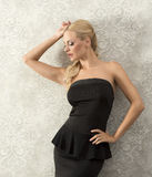 Sensual blond in black dress royalty free stock photography