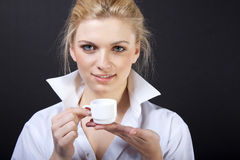 Sensual blond with cup Royalty Free Stock Photography