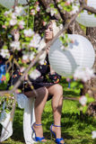 Sensual Blond Female Relaxing In Spring Forest on Swing. Huge Wh Stock Image