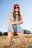 Sensual blond girl in field. Beautiful romantic girl outdoors. Attractive girl in a summer field Stock Image