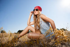 Sensual blond girl in field. Beautiful romantic girl outdoors. Attractive young girl in a summer field Stock Photo