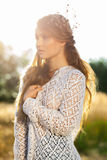 Sensual blond girl in field. Beautiful romantic girl outdoors. Attractive young girl in a summer field in autumn at sunset Royalty Free Stock Photos