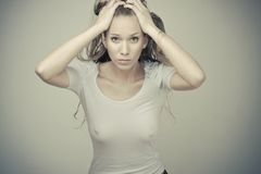 Sensual blond girl in wet t-shirt. Sensual beautiful blond girl in wet white t-shirt Royalty Free Stock Photography
