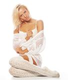 Sensual blond girl in white lingerie and socks Royalty Free Stock Photography