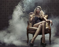 Sensual blond lady in the retro grunge place Stock Photography