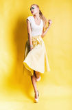 Sensual blond woman in long yellow skirt Royalty Free Stock Image