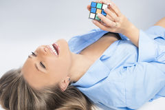Sensual Blond Woman Playing With Cube Stock Photo