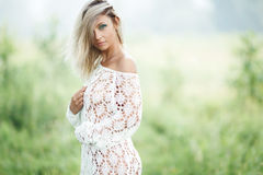Sensual blond woman in white dress outdoors Stock Image