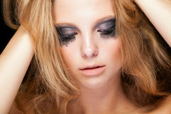Sensual blonde with cryed black make up Stock Photo