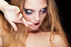 Sensual blonde with cryed black make up Royalty Free Stock Photos
