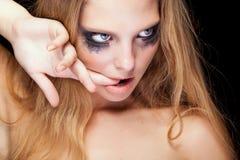 Sensual blonde with cryed black make up Royalty Free Stock Photos