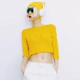 Sensual blonde DJ in bright clothes