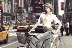 Sensual blonde girl with bicycle Royalty Free Stock Images