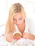 Sensual blonde girl drinking her morning coffee Stock Image