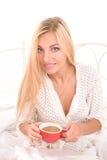 Sensual blonde girl drinking her morning coffee Stock Photos