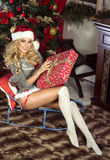 Sensual blonde girl in Santa Claus costume Royalty Free Stock Photos