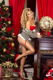 Sensual blonde girl in Santa Claus costume Stock Image