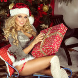 Sensual blonde girl in Santa Claus costume Stock Photography