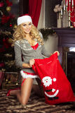 Sensual blonde girl in Santa Claus costume Royalty Free Stock Photo