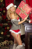 Sensual blonde girl in Santa Claus hat Royalty Free Stock Images