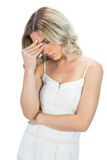 Sensual blonde having headache touching her forehead Royalty Free Stock Photography