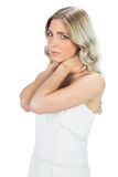 Sensual blonde holding her painful neck Royalty Free Stock Photography