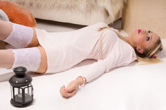 Sensual blonde lying on the floor Royalty Free Stock Photo