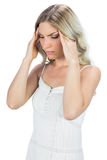 Sensual blonde massaging her temples Stock Photo
