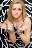 Sensual blonde stretches out her hands in chains Royalty Free Stock Photo