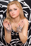Sensual blonde stretches out her hands in chains Royalty Free Stock Images