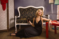 Sensual blonde in the vintage interior Stock Photography